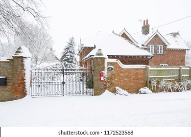 Entrance to an English country house exterior covered in snow in winter