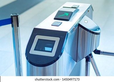 Entrance with e-pass. Turnstile spinner with a card application. Automatic checkpoint with contactless access. Turnstile with card reader. Electronic checkpoint. Access control system.