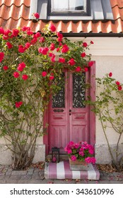 Entrance with flowers to  a town house in Visby on the island Gotland, Sweden