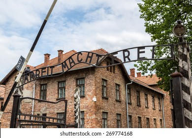 Entrance gate to Auschwitz concentration camp in Poland in summer day