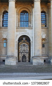 An entrance gate to the Clarendon building on Broad Street Oxford leading to the Sheldonian Theatre and the Bodleian Library the translation of the text on the University crest is the Lord is my light