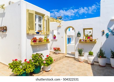 Entrance gate to typical Greek style apartments on street in Naoussa town on Paros island, Greece