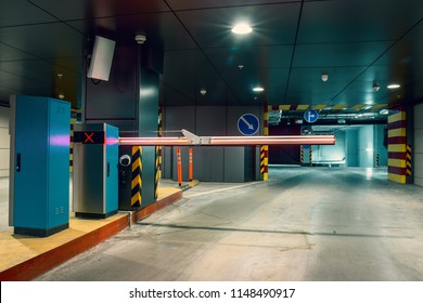 Entrance gate to underground garage parking lot, auto park interior inside, toned