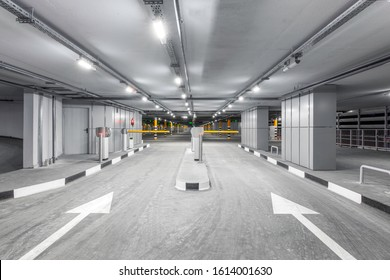 Entrance gate to underground garage parking. Automobile parking inside.