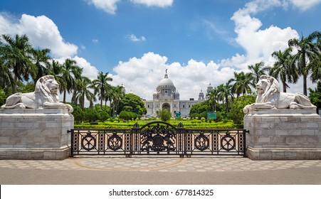 Entrance gate with white marble lions of Victoria Memorial architectural monument and museum at Kolkata, India.