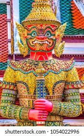 Entrance Guardian at The Bangkok Wat Phra Kaew and Grand Palace complex.  Bangkok, Thailandia.