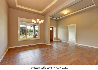 Entrance hall of brand new house with coffered ceiling and hardwood floor. Northwest, USA