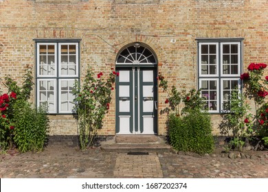 Entrance to the historic monastery in Holm village of Schleswig, Germany