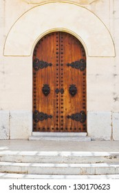 Entrance of a historical church with ornaments and wooden old doors