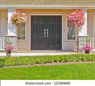 Entrance of a house with some flowers aside.