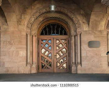 Entrance inlaid wooden door to the church Kreuzeskirche in Essen, Germany. Evangelical Church of Essen