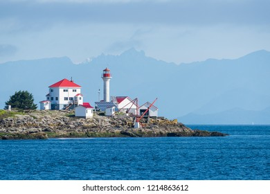 Entrance Island, British Columbia, Canada September 25, 2018 - Beautiful red and white Entrance Island Lighthouse just off the shore of Gabriola Island in the Strait of Georgia by Vancouver Island.