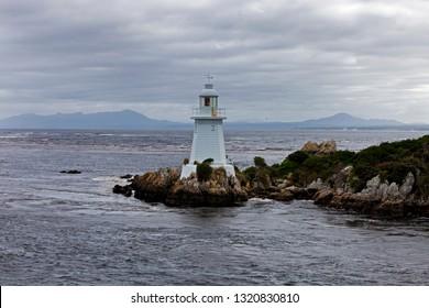 The Entrance Island Lighthouse. Guards the hazardous 120 meter wide entrance into Macquarie Harbour.Known as Hells Gates.West Coast of Tasmania,Australia.