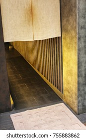 The entrance to the Japanese restaurant decorated retro style curtains combined with modern architecture.