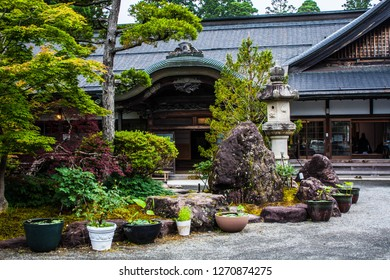 An entrance to a japanese traditional hotel. Sliding doors at a ryokan in Japan. A yard of a traditional japanese inn. Tranquil old-styled hotel in Japan. Minshuku - a small hotel in a family house.