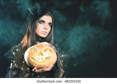 Entrance is limited to nightclub, dress code. Fashion young woman with pumpkin going to Halloween party 2016! Beautiful woman like witch. Hallowen costumes, pumpcin. Copy space background