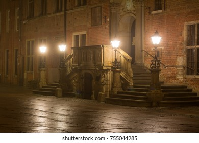Entrance to the Main Town Hall in Old Town of Gdansk in the fog at night. Poland.