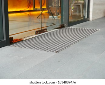 Entrance mat on the floor of main entrance of luxury condominium for preventing dust from shoes into building. It made of PP carpet and aluminium track which total size is 50 cm width and 1.6 m