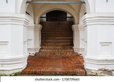 Entrance in medieval estate with brick steps and white columns. Kremlin