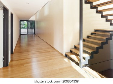 entrance of a modern villa, corridor and stairs view
