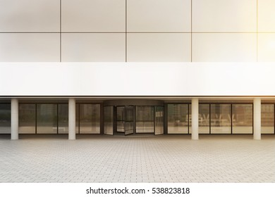 Entrance to the office building with white walls and glass doors. Concept of work in a large company. 3d rendering. Mock up. Toned image