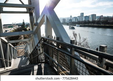 With it's entrance on the Burnside Bridge, this staircase takes you down to the Eastbank Esplanade overlooking the Willamette River, the downtown Portland skyline and the I-5 highway.