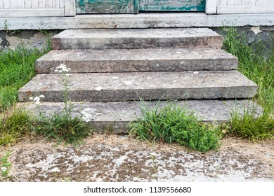 Entrance on weathered stone steps into an old house