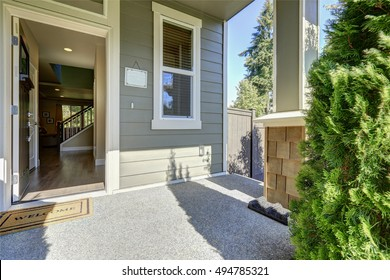 open front door. Entrance Porch Of American Gray House With Open Front Door Welcome Mat  On A Sunny E
