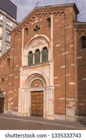 entrance portal of  Romanesque san Babila church in city center, shot in bright winter light at Milan, Lombardy, Italy