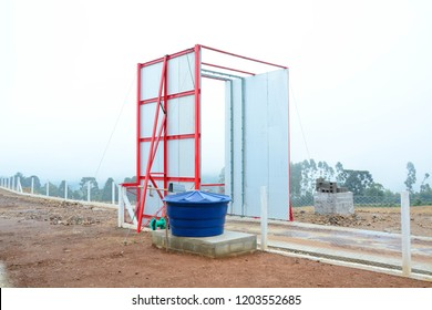 Entrance of a poultry farm with a vehicle desinfection station for Biosecurity