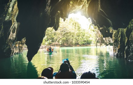 Entrance of Puerto Princesa Palawan subterranean underground river - Adventurous exclusive Philippines destinations seven nature wonders - Contrast back lighting filter with point of view composition