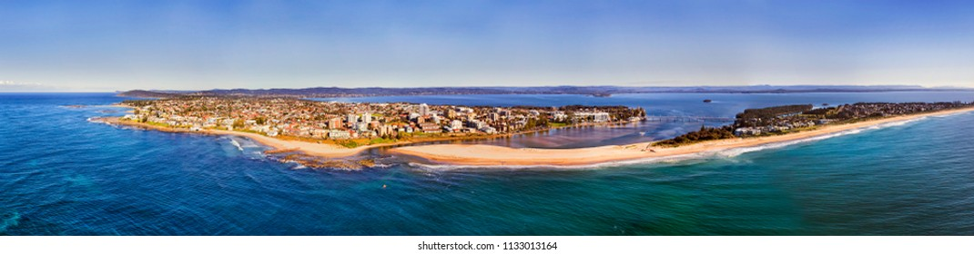 The entrance regional town on Australian Central coast of Pacific where Tuggerah lake enters the ocean via lagoon flowing through sandy dunes and beaches.