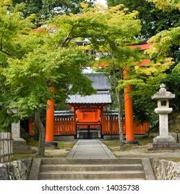 Entrance of Reihibyou Shrine with orange Torii gate near Tenryuji temple