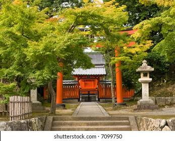 Entrance of Reihibyou Shrine with orange torii gate near Tenryuji temple which holds the  emperor Godaigo