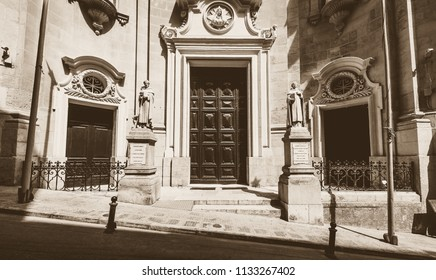Entrance to Saint Dominic Church Valletta Malta, high contrast sepia tone summer 2018 Baroque architecture