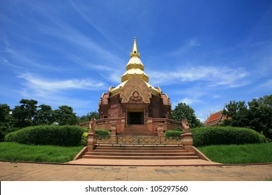 Entrance of sandstone pagoda statue against blue sky at Wat Pa Salawan in Nakhon Ratchasima province, Thailand
