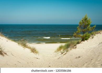 Entrance to sandy beach, Baltic Sea in Piaski, Poland