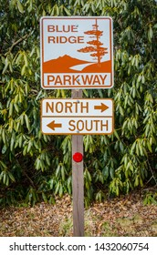 An entrance sign to the Blue Ridge Parkway points tourists to the north and south