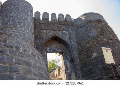 The entrance to Sinhagad. Sinhagad (Sinhgad) is a hill fortress located at southwest of the city of Pune, India. The fort could have been built 2000 years ago.
