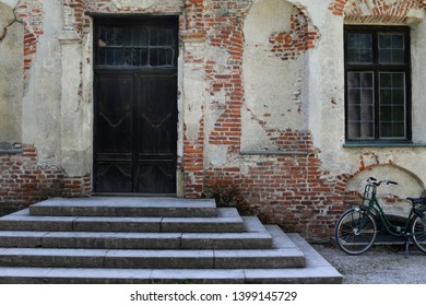 Entrance of the so-called Parkburg with green bicycle in the historical park of Nymphenburg palace in Munich, Bavaria, Germany