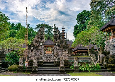 "The entrance with split gateway which is called ""candi bentar"". Traditional balinese architecture in Gunung Lebah temle, Ubud, Bali, Indonesia"