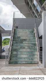 Entrance stairs to the side of the building.