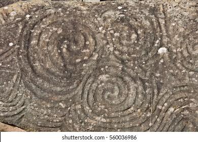 Entrance stone in Newgrange, very old historical site in Ireland.