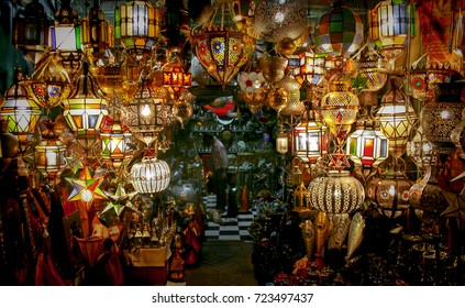 Entrance to a store in Marrakech decorated with traditional lamps in various forms and colors