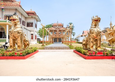 at the entrance of the temple there are two giant golden dragons