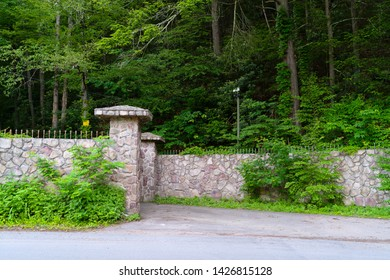 Entrance through the gates to the territory under the close supervision of the security camera on the banks of then Neversink River, tributary of the Delaware River and Guymard Turnpike, Unique Area