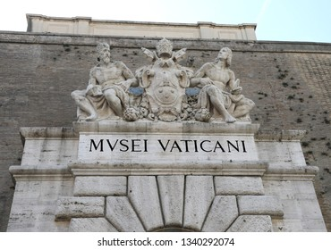Entrance to the Vatican Museums in the Vatican City and the great text over the gate