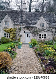 An entrance way with flowers in Cotswold, England