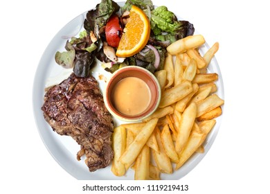 Entrecote with french fries and salad, top shot