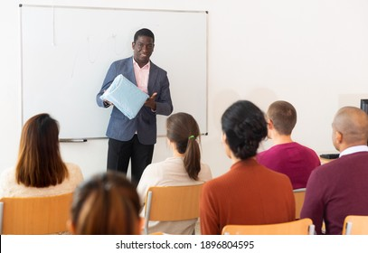 An entrepreneur advertises product at a business training